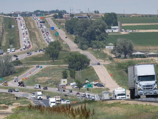 Heavy traffic flows on Interstate 25 near Berthoud