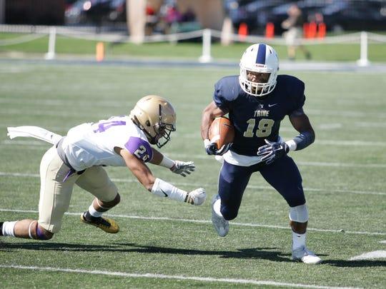 Fremont Ross grad Jeffery Barnett runs with the football for Trine University.