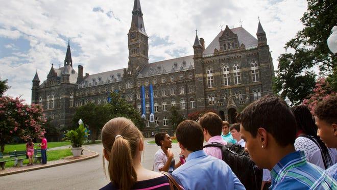 Prospective students tour Georgetown University's campus in Washington.