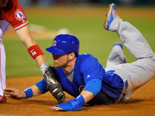 Chicago Cubs' Ben Zobrist, right, is picked off by Los Angeles Angels first baseman C.J. Cron during the fifth inning of an opening day baseball game, Monday, April 4, 2016, in Anaheim, Calif. (AP Photo/Mark J. Terrill)
