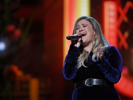 Kelly Clarkson performs at the CMA Country Christmas at the Opry House.
