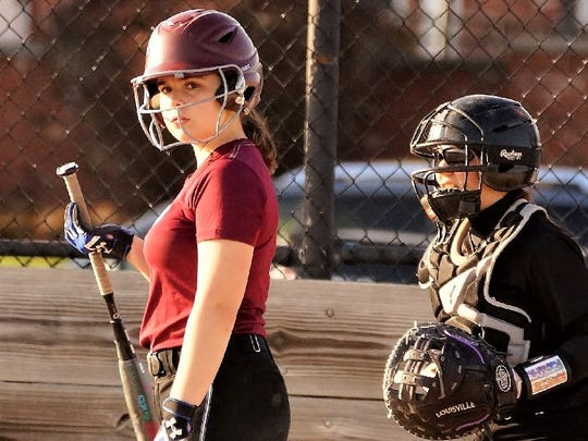 After starting the season hitting .133, Seaholm's Bryn Longe (left) has upped her average to .349.