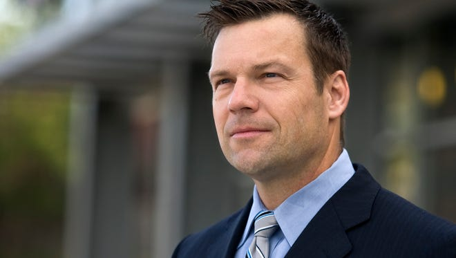 In this May 3, 2010 photo, Kris Kobach poses for a photo in Kansas City, Mo.