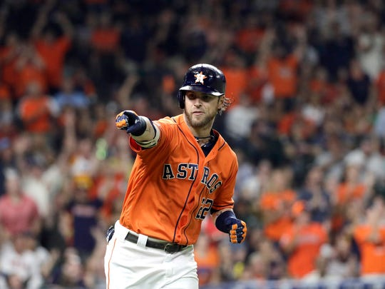 Houston Astros' Josh Reddick points to the dugout after hitting a home run against the Seattle Mariners during the fourth inning of a baseball game Friday, Sept. 6, 2019, in Houston. (AP Photo/David J. Phillip)