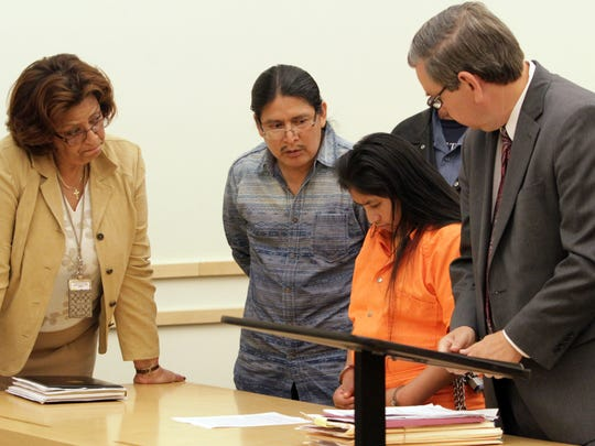 From left, Spanish interpreter Laura Rodriguez and Kichwa language interpreter Fabian Muenals and attorney Kenneth Murphy ask Maria Guaman-Guaman a question Sept. 15, 2014 during her sentencing for killing her newborn son. The 24-year-old Ecuadoran living in Spring Valley was sentenced to 12 years by state Supreme Court Justice William Kelly at the Rockland County Courthouse in New City.