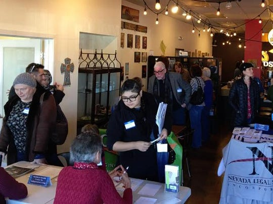 """People meet and greet local Reno nonprofits at Rounds Bakery in a January event called """"What can I do?"""""""