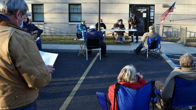 The Union Township board held its meeting in the parking lot Dec. 10 because of COVID-19 restrictions.