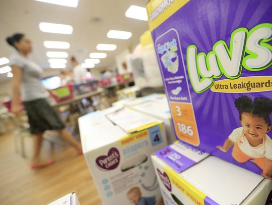 Diapers are one of the items families can receive at Love Life ministry at Peace United Methodist Church on Thursday in Green Bay. Adam Wesley/USA TODAY NETWORK-Wisconsin