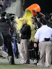 Coach Bobby Johnson gets doused with Gatorade near the end of the 2008 Music City Bowl, a win over Boston College.
