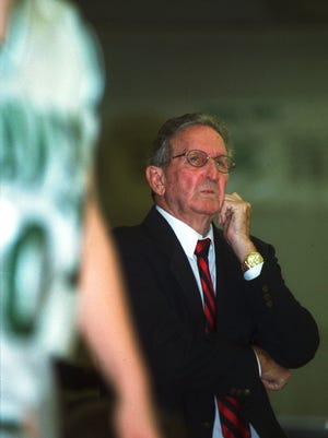 Fort Myers High School girls basketball coach Elmer Tremont watches intently from the sidelines as his team battles it out during a close game with Cypress Lake at Fort Myers in 2002.