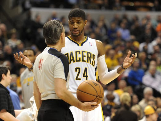 Indiana's Paul George asks official Ken Mauer why he was called for a foul in the third quarter as the Golden State Warriors defeated the Indiana Pacers 98-96 at Bankers Life Fieldhouse Tuesday March 4, 2014.