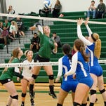 Novi's Jen Smith (13) goes on the attack with setter Erin O'Leary lending support in Tuesday's win over Salem.