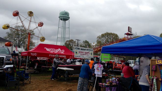 People attend the 2015 Louisiana Nursery Festival in Forest Hill. An audit released Monday cited the village for not paying some employees who worked the annual festival through its payroll system, which meant payroll taxes weren't withheld. The audit also had about 20 other findings.