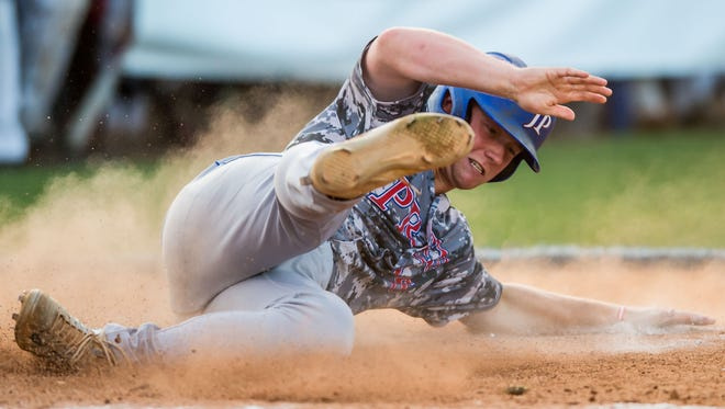 Jackson Prep's Matthew Myers slides safely into home against Jackson Academy during the MAIS AAAA Championship Game One held at Jackson Academy Tuesday.