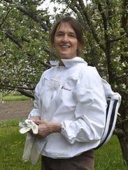 Gretchen Schmelzer of Sturgeon Bay in her bee suit