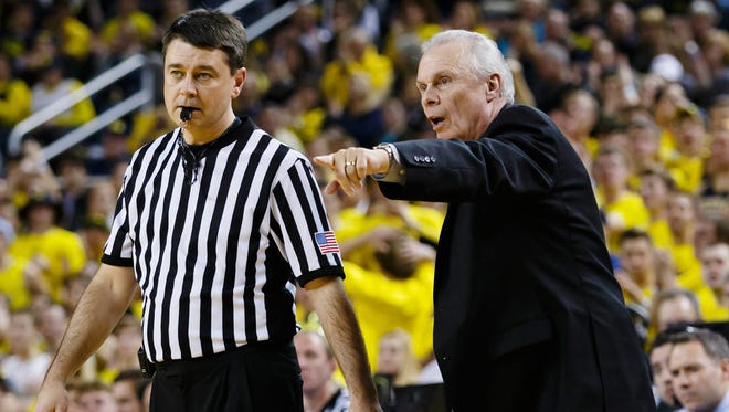 Wisconsin Badgers head coach Bo Ryan talks to a referee during the second half against the Michigan Wolverines at Crisler Center. Wisconsin won 69-64 in overtime.