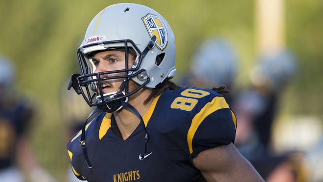 Krishawn Hogan scored two rushing touchdowns to help Marian defeat Robert Morris on Saturday.