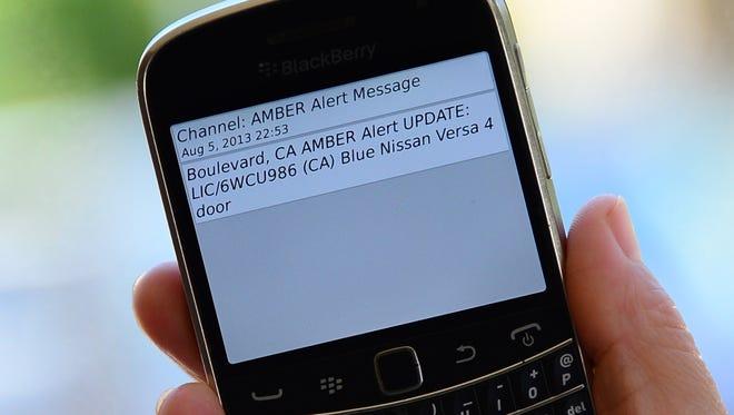 A cellphone displays an Amber Alert.