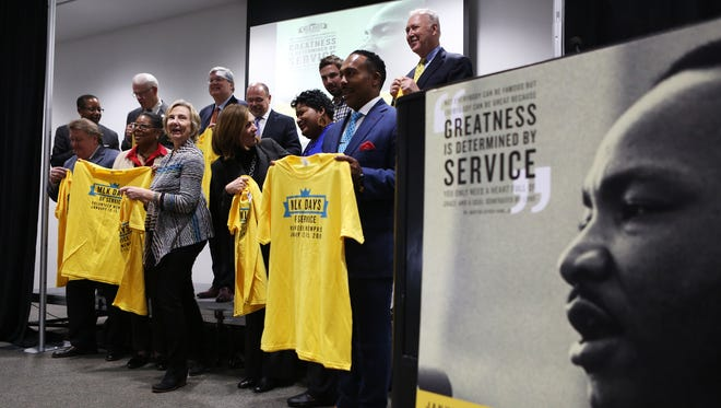 Community leaders display their MLK Days of Service T-shirts after posing for photos Jan. 11, 2018, at the conclusion of the 2018 MLK Days of Service news conference at the Benjamin L. Hooks Central Library. Various service projects will take place from Friday through Monday, Martin Luther King Jr. Day.