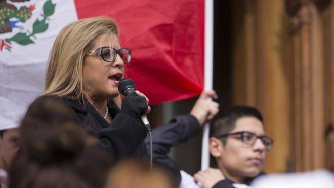 Mara Candelaria Reardon, a member of the Indiana House of Representatives, speaks at a march and rally on Feb. 16, 2017.