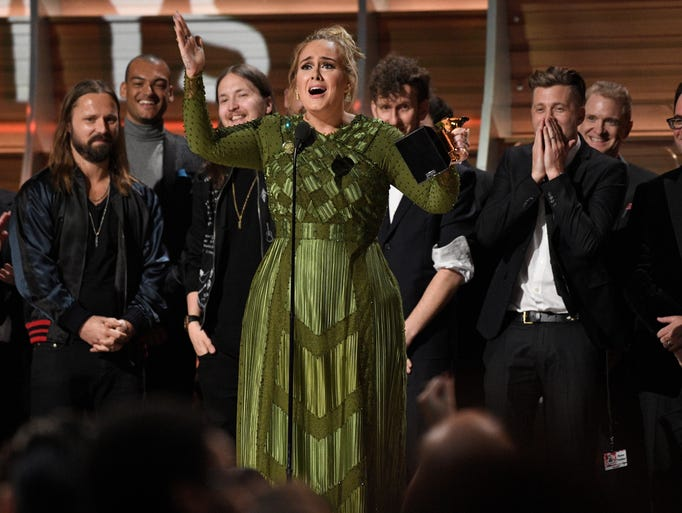 Adele accepts the award for Album of the Year during
