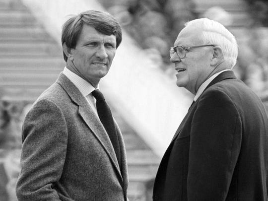 Vanderbilt Director of Athletics Roy Kramer, right, talks with Alabama head coach Ray Perkins before the game in Tuscaloosa Sept. 29, 1984.