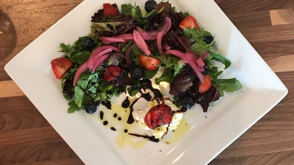 The Truffled Burrata Salad at Rogue River Taproom in Indialantic is made with arugula, seasonal fruit, fresh herbs, balsamic, truffle oil and house-pickled red onions.