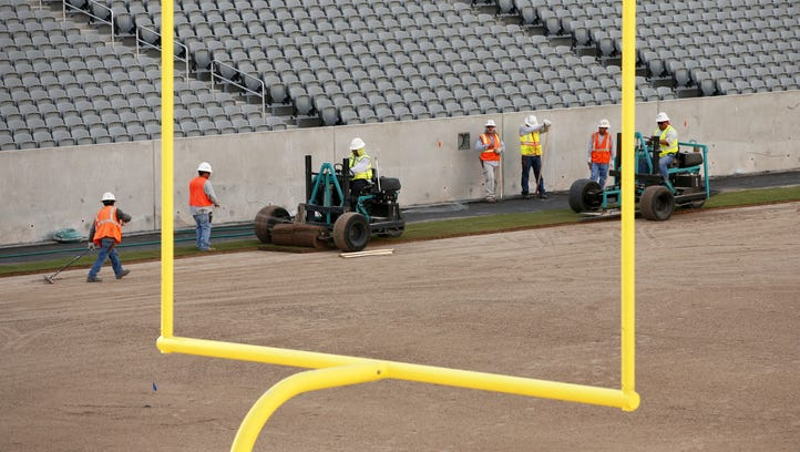 Crews lay new sod for the football field at Sun Devil Stadium in Tempe, Ariz., on Thursday, July 21, 2016. The Sun Devils kick-off their home season on Sept. 3rd against Northern Arizona. Sun Devil Stadium is undergoing a multiyear, major renovation.