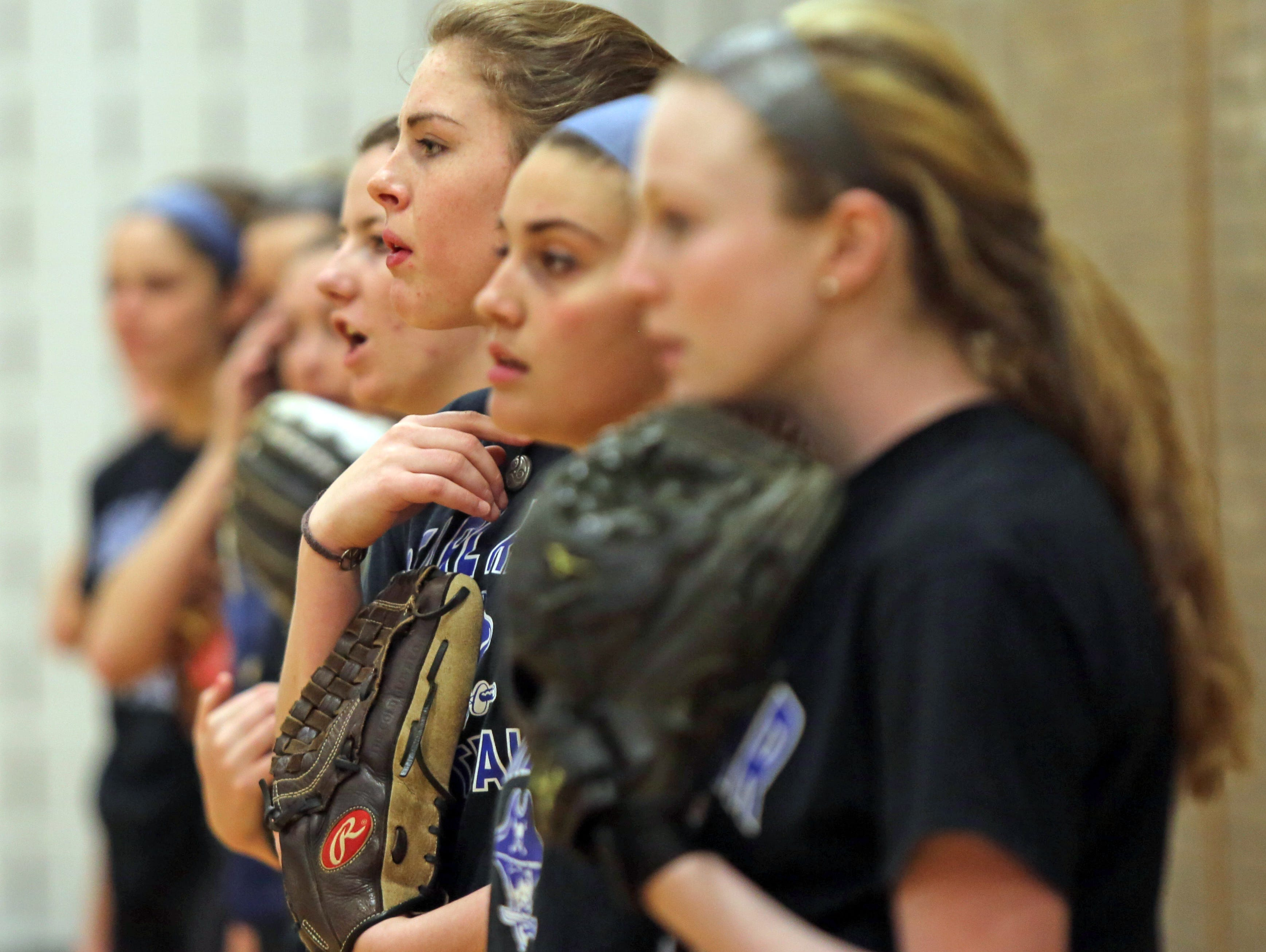 Meagan Woods (near) and her Pearl River softball teammates watch on during an indoors practice at the high school on March 14, 2016.