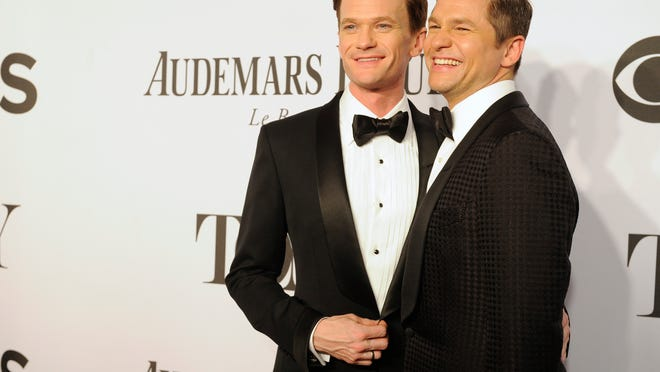 FILE - In this June 8, 2014 file photo, Neil Patrick Harris, left, and David Burtka arrive at the 68th annual Tony Awards at Radio City Music Hall in New York. The ìHow I Met Your Motherî star and his actor-chef groom were married Sept. 6, in Italy. Theyíd been dating for 10 years and are parents to 3-year-old twins, Gideon and Harper.  (Photo by Charles Sykes/Invision/AP, File) ORG XMIT: NYET122