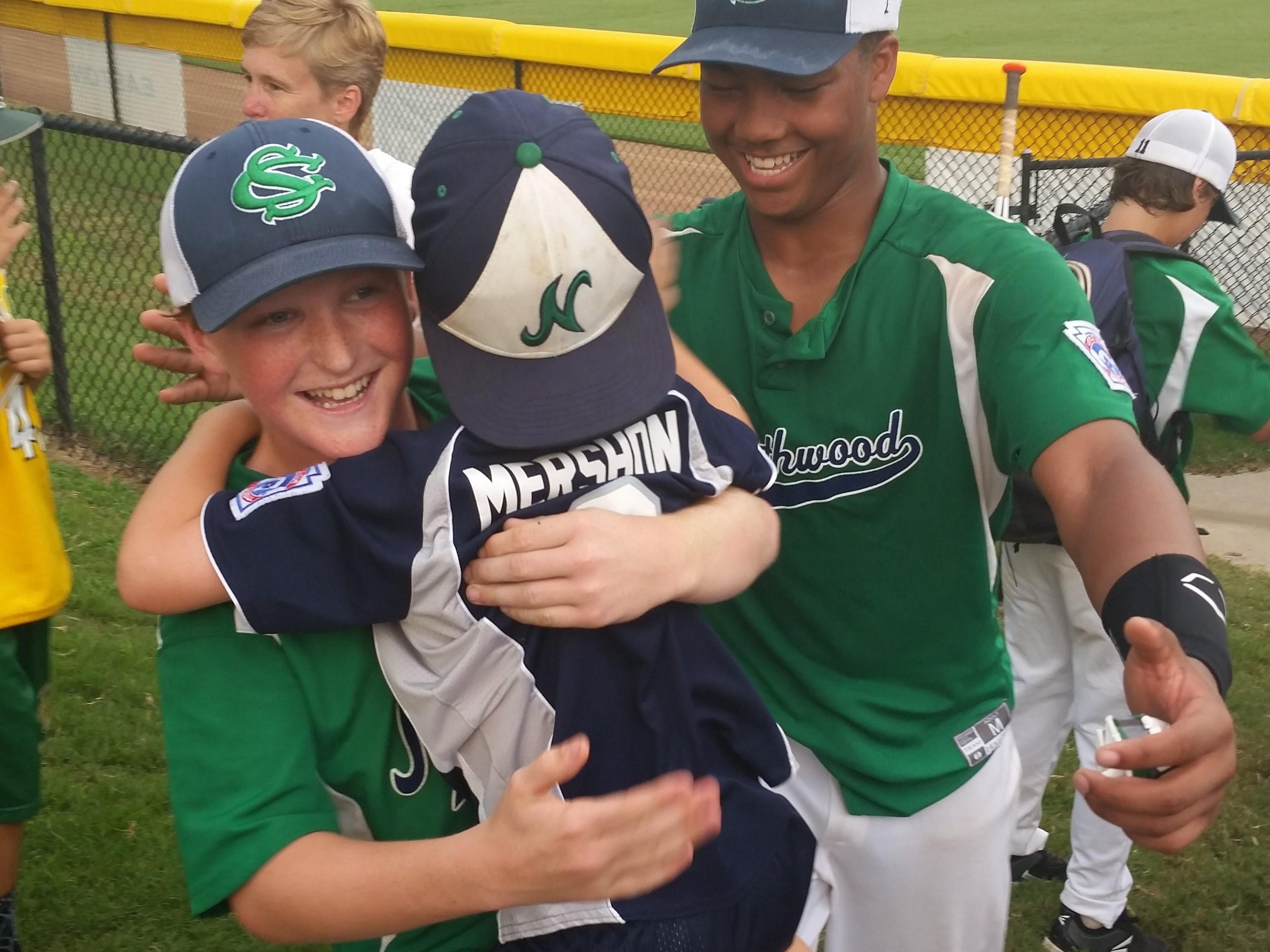 Northwood Little League players Ryan Chapman, left, and Terrence Gist celebrate with William Mershon, younger brother of second baseman David Mershon, after Northwood's 7-0 win over Virginia in the Southeast Regional championship.