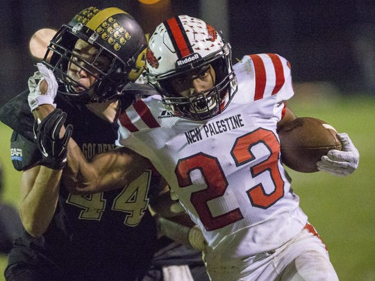 DuRon Ford of New Palestine, tries to shed tackler Nathan Phillips of Shelbyville, during the third quarter, New Palestine High School at Shelbyville High School in a battle of unbeatens, Shelbyville, Friday, Sept. 30, 2016.