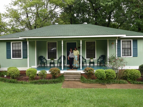 Willie Mae Brown and daughter Tyna McNealy stand on the porch of their Habitat for Humanity home built in 1991.