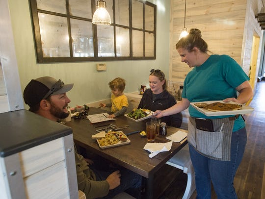 Amy Elliott serves breakfast at Egg & I's original midtown location on Friday, October 20, 2017. The popular breakfast and brunch spot, now franchised across the country, is celebrating 30 years after getting its start in Fort Collins.