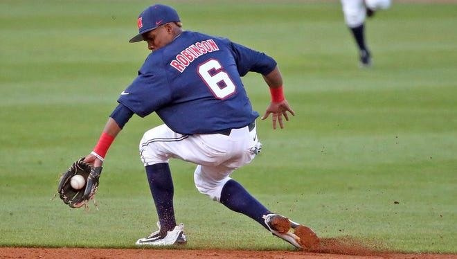 Shortstop Errol Robinson fields a ground ball during a recent game. After a slow start on offense, the preseason All-American has been hitting well of late.
