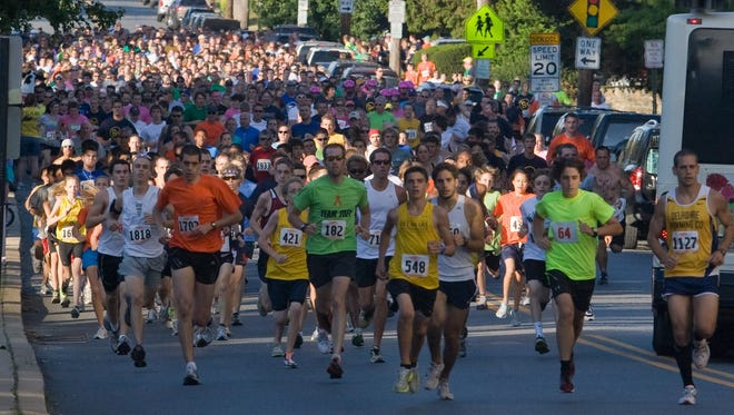 Runners embark during an Andrew McDonough B+ Foundation 5K down N. Broom Street.