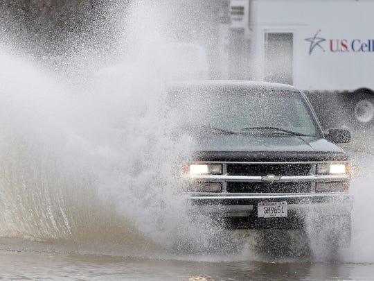 A truck drives through high water along West American