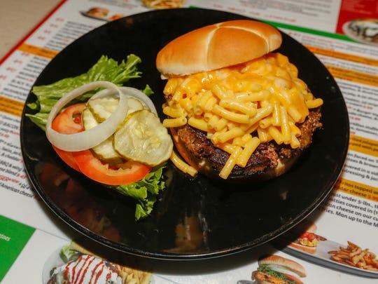 "Bair's is offering the ""Jake Burger"" Mac 'N Cheese hamburger in honor of former MSU slugger Jake Burger."