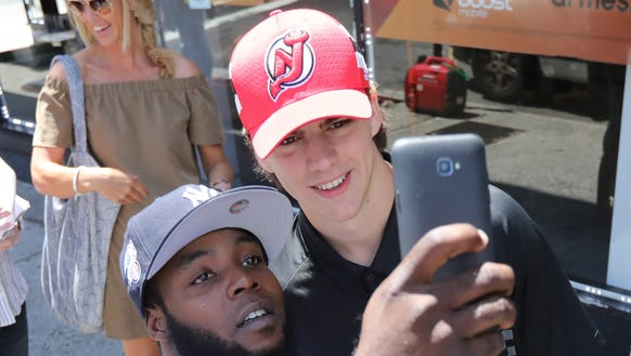 Devils fan, Kahlid Alston, takes a selfie with No.
