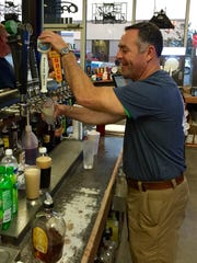 Owner Ray Gill pours a beer from the tap at Jack's. Gill is teaming up with friends Edan Moran and Mike Brunet to open a microbrewery at the bar on La. Highway 28 West