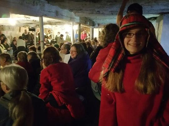 A shepherd poses for a photo in front of the audience of the Live Christmas Nativity.