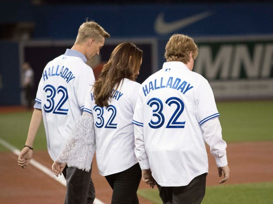 Toronto, Ontario, CAN; Toronto Blue Jays player Roy Halladay wife and sons in attendance for a special dedication ceremony before the home opener against the New York Yankees at Rogers Centre Mar 29, 2018.
