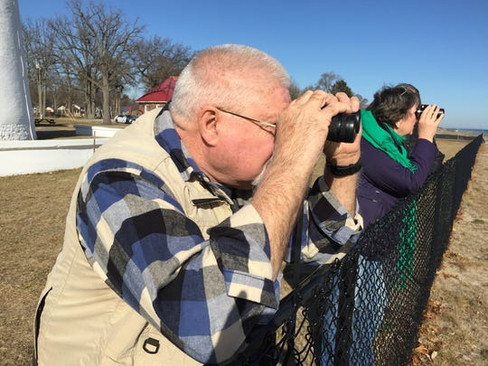 Ralph Thibodeau, of St. Clair, focuses on a group of waterfowl during the Winter Bird Blast on Saturday.