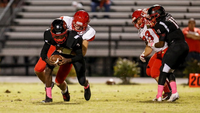 PRP quarterback B.J. Robinson (2) is sacked by the Scott Co. defense on Friday, Oct. 20, 2017.