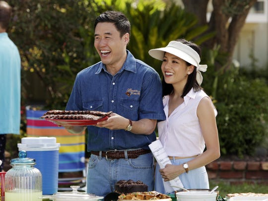 Randall Park, left, and Constance Wu appear in a scene