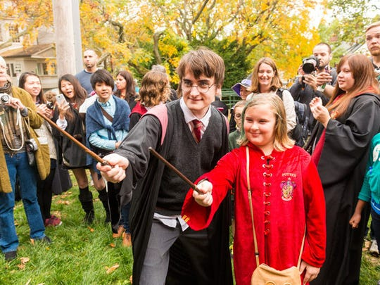 Harry gives a 'student' a wand lesson during a Harry Potter festival.