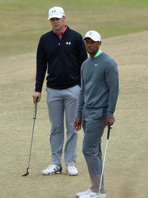 Tiger Woods (front) and Jordan Spieth (back) look on the eighth green during practice rounds on Tuesday at Chambers Bay.