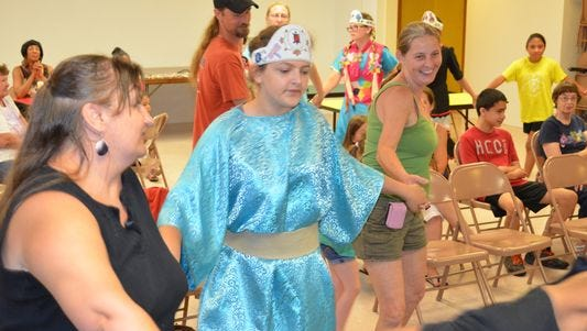 File: Crystal Ridgway of Fairton, Samantha Ridgway of Fairfield and Kim Overstreet of Vineland weave through the audience during a group dance at a program presented by the Nanticoke Lenni-Lenape Tribal Nation.
