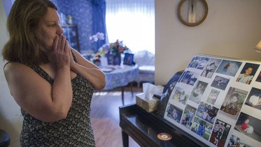 Dorothy McIntosh Shuemake, mother of Alison Shuemake, pauses as she looks at a picture collage of her daughter during an interview at her home, in Middletown, Ohio. Alison Shuemake, 18, died Aug. 26, after a suspected heroin overdose.