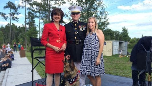 Jeannie Blaylock with Marine Capt. Jason Haag, his wife and Axel at the Grand Opening of the K9s For Warriors 'Camp K9' in Nocatee, Fla. April 30, 2015.